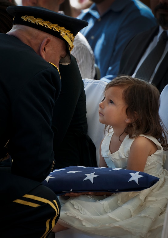 Army Chief of Staff Gen. Ray Odierno comforts Audrey Baker, daughter of Sgt. 1st Class Jeff Baker, during the 45th Annual Explosive Ordnance Disposal Memorial Ceremony May 3, at Eglin Air Force Base, Fla. Eight new names of Army and Marine EOD technicians, who lost their lives, were added to the Memorial Wall this year.  The all-service total now stands at 306. (U.S. Air Force photo/Tech. Sgt. Sam King)