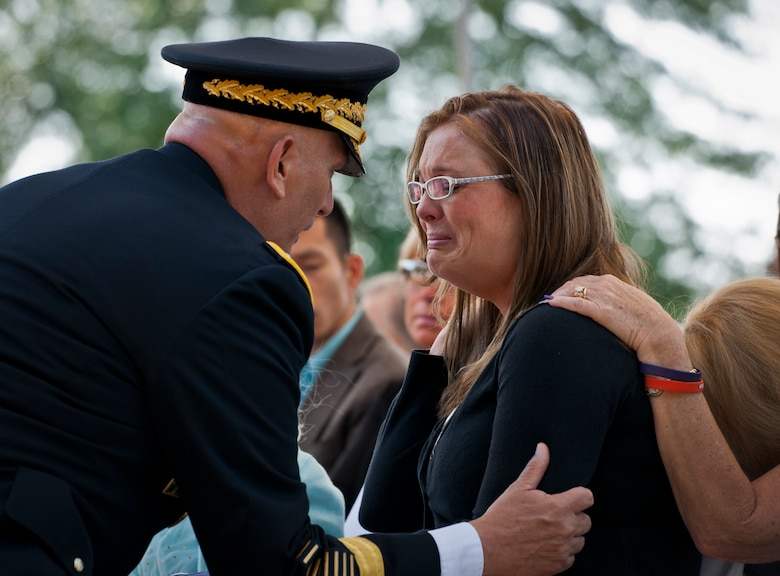 Army Chief of Staff Gen. Ray Odierno comforts Mandi Bennett, widow of Staff Sgt. Wade Bennett, during the 45th Annual Explosive Ordnance Disposal Memorial Ceremony May 3, at Eglin Air Force Base, Fla. Eight new names of Army and Marine EOD technicians, who lost their lives, were added to the Memorial Wall this year.  The all-service total now stands at 306. (U.S. Air Force photo/Tech. Sgt. Sam King)