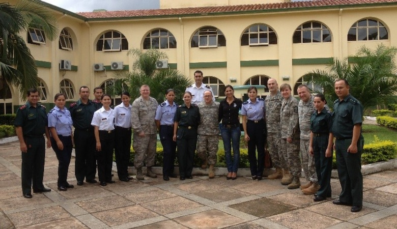 Members of the Massachusetts National Guard post with members of the Paraguayan military during a trip to Paraguay. The soldiers and airmen were there as part of the National Guard's State Parternership Program, which fosters an exchange of ideas and knowledge between a state and its host country.