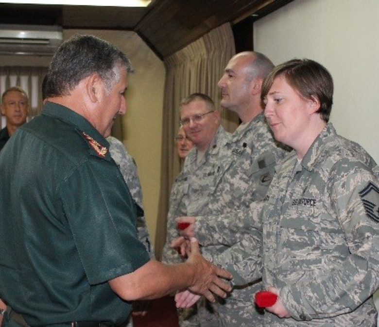 SMSgt. Cynthia Thomas shakes hands with Maj. Gen. Carlos Antonio Caballero Maidana of the Paraguyan Army. SMSgt. Thomas and other members of the Massachusetts National Guard were in Paraguay as part of the National Guard's State Parternership Program.