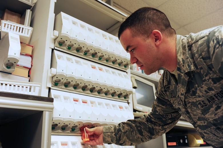 Staff Sgt.  Adam Keegan, 39th Medical Group pharmacy technician, refills a prescription May 5, 2014, Incirlik Air Base, Turkey.  Airmen who take prescription pills that are not their own or are taken after the time allotted could find themselves facing severe disciplinary actions. (U.S. Air Force photo by Senior Airman Nicole Sikorski/Released)