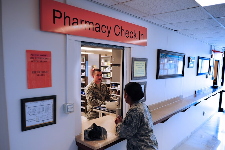 Staff Sgt.  Adam Keegan, 39th Medical Group pharmacy technician, checks in a patient May 5, 2014, Incirlik Air Base, Turkey.  Controlling medications that are dispensed to patients is a top priority at the 39th MDG pharmacy. (U.S. Air Force photo by Senior Airman Nicole Sikorski/Released)