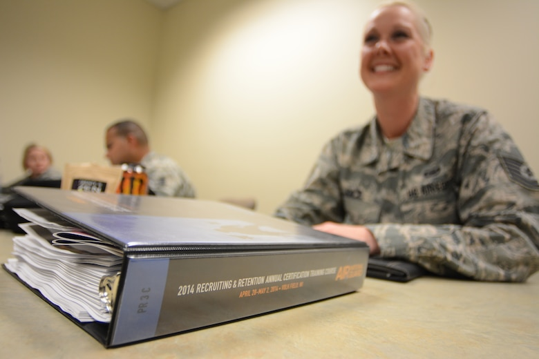 Air National Guard recruiters were given binders full of training information to utilize during the 2014 Recruiting and Retention Annual Certification Training Course at Volk Field Air National Guard Base, Wis., April 28, 2014. More than 600 recruiters from across the nation attended the event April 27-May 2. (Air National Guard photo by Senior Airman Andrea F. Liechti)