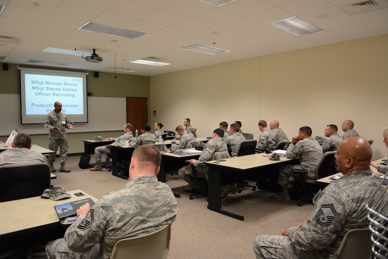 A group of Air National Guard recruiters attend a training class during the 2014 Recruiting and Retention Annual Certification Training Course at Volk Field Air National Guard Base, Wis., April 28, 2014. More than 600 recruiters from across the nation attended the event April 27-May 2. Throughout the week they were divided into smaller groups to receive hands-on training with National Guard Bureau instructors. (Air National Guard photo by Senior Airman Andrea F. Liechti)