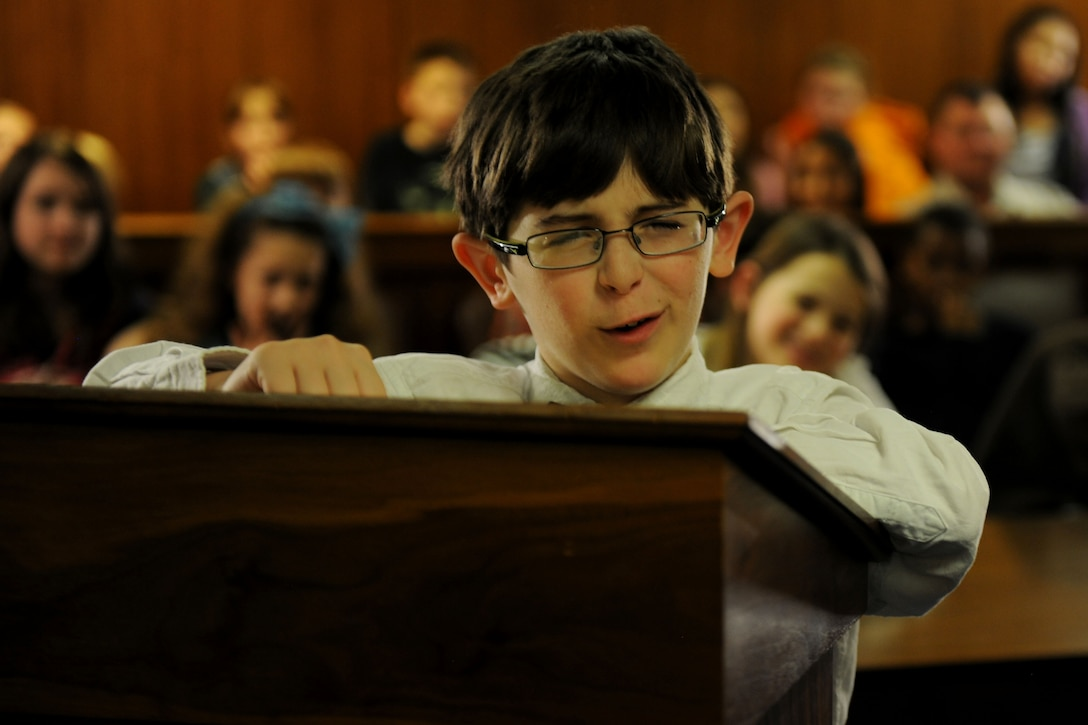Eli Morris, Alconbury Elementary School student and prosecutor against Benjamin Bradley Wolf, attempts to poke holes in the defense's theory that allergies caused the wolf to blow down a house of straw and sticks, during the 2014 Law Day mock trial at RAF Alconbury, United Kingdom, May 1, 2014. Despite Morris' impassioned argument, the jury still found the wolf innocent. (U.S. Air Force photo by Staff Sgt. Jarad A. Denton/Released)