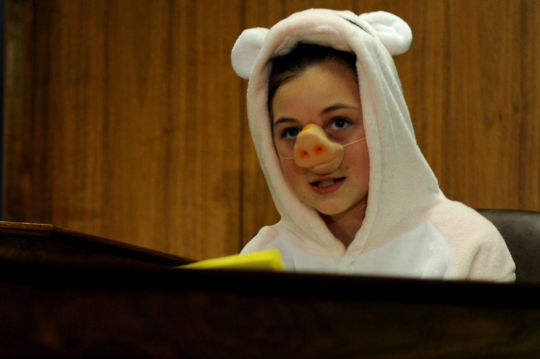 The first little pig, portrayed by Alconbury Elementary School student Cheyanne Storie, delivers her testimony during the mock trial of Benjamin Bradley Wolf at RAF Alconbury, United Kingdom, May 1, 2014. The trial, part of the 2014 Law Day and hosted by the 501st Combat Support Wing Judge Advocate Office, allowed the students to see the inner workings of an actual courtroom. (U.S. Air Force photo by Staff Sgt. Jarad A. Denton/Released)