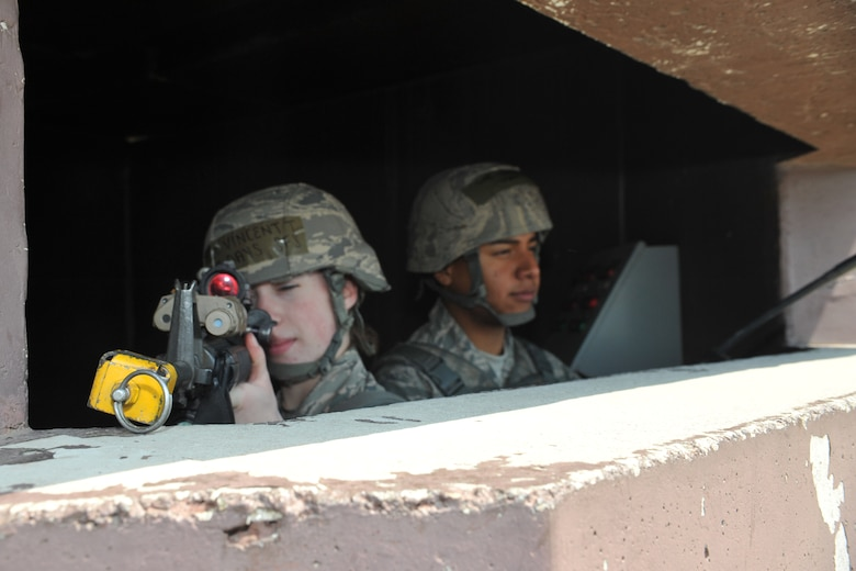 Airman 1st Class Tiffani Vincent and Senior Airman Pavel Aragon, 51st Security Forces Squadron entry controllers, man a defensive fighting position outside Bldg. 1097 during Operational Readiness Exercise Beverly Bulldog 14-02 at Osan Air Base, Republic of Korea, May 5, 2014. Defenders placed in DFPs must stay alert for any possible suspicious activity in the area. (U.S. Air Force photo/Airman 1st Class Ashley J. Thum)