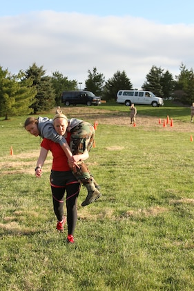 Olivia Waugh, a future U.S. Marine Corps officer candidate, carries Rebekah Mazany during a Combat Fitness Test held during an Officer Candidates School preparatory weekend at Camp Woodward, Pa. April 25-27, 2014. The purpose of the weekend was to give the candidates a realistic view of how physically, mentally and emotionally demanding OCS will be. (U.S. Marine Corps photo by Sgt. Tyler Hlavac/Released)