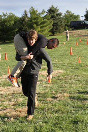 Greg Haylett, a future U.S. Marine Corps officer candidate, carries Sam Cosen during a Combat Fitness Test held during an Officer Candidates School preparatory weekend at Camp Woodward, Pa. April 25-27, 2014. The purpose of the weekend was to give the candidates a realistic view of how physically, mentally and emotionally demanding OCS will be. (U.S. Marine Corps photo by Sgt. Tyler Hlavac/Released)