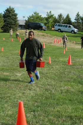 Malik Birks, a future U.S. Marine Corps officer candidate, carries a pair of ammo cans during a Combat Fitness Test held during an Officer Candidates School preparatory weekend at Camp Woodward, Pa. April 25-27, 2014. The purpose of the weekend was to give the candidates a realistic view of how physically, mentally and emotionally demanding OCS will be. (U.S. Marine Corps photo by Sgt. Tyler Hlavac/Released)