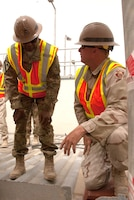 Construction representative Shawn Huebner (right) briefs Lt. Gen. Thomas Bostick, Chief of Engineers, while on the job in Afghanistan.