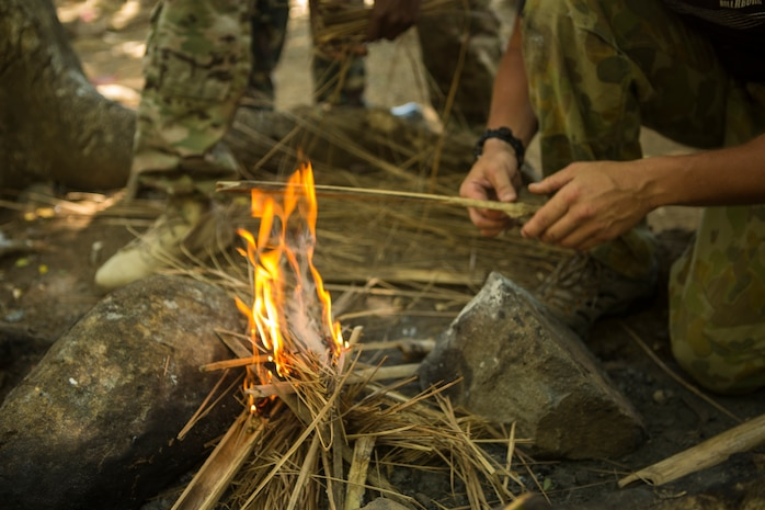 Australian and U.S. Special Operations Forces Soldiers start a fire during jungle survival training led by Philippine SOF Soldiers at Fort Magsaysay, Philippines, May 5, 2014. Philippines, Australian and U.S. Special Operations Forces will be training together over the next three weeks during Balikatan 2014. The Armed Forces of the Philippines and U.S. have had a long-standing relationship and welcome the Australian Defence Forces increasing participation in Balikatan.