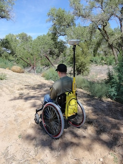 BERNALILLO COUNTY, N.M., -- Bryan Estvanko surveys using equipment set up by fellow District employee Ronnie Casaus.  Taken Sept. 23, 2012 on the Rio Grande Levee in the Bosque by Gary Edwards.