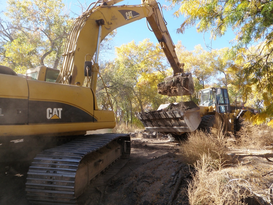 ALBUQUERQUE, N.M., -- An excavator fills a loader after a channel dig Oct. 25, 2012 as part of the Middle Rio Grande Restoration Project in the Bosque near Tingley Ponds. Photo by Jacob Chavez.