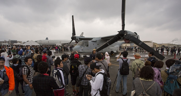 Patrons gather around an MV-22B Osprey aircraft as they observe and take photos of the aircraft during Friendship Day aboard Marine Corps Air Station Iwakuni, Japan, May 5, 2014. The Osprey is with Marine Medium Tiltrotor Squadron 265 from 1st Marine Aircraft Wing, Okinawa, Japan. Friendship Day is an event that allows Japanese citizens a chance to see military vehicles and aircraft, meet American service members and get a taste of American culture.
