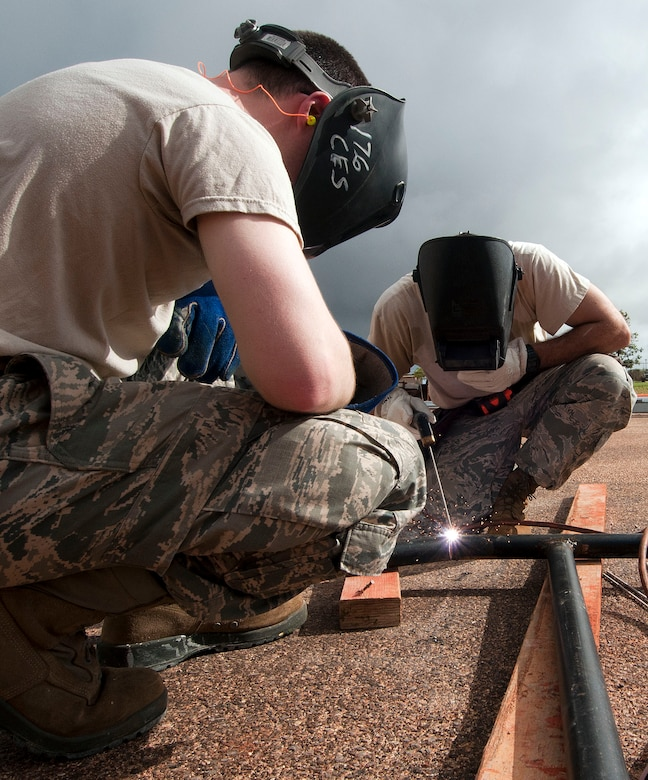 H.E. HOLT NAVAL COMMUNICATION STATION, Australia – Airman 1st Class Phillip Gifford, left, and Tech. Sgt. Mark Hill of the Alaska Air National Guard's 176th Civil Engineer Squadron weld a safety railing here May 6, 2017. Thirty-four Alaska Air Guard members, most from the 176th CES, deployed for two weeks to this tiny outpost at the far western tip of Australia to help build a space radar facility to be jointly operated by Australia and the United States. U.S. Air National Guard photo by Capt. John Callahan/ Released.