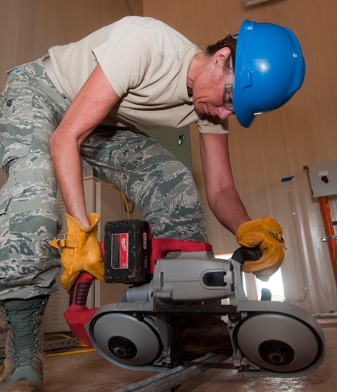 H.E. HOLT NAVAL COMMUNICATION STATION, Australia – Master Sgt. Bonnie Gardino, utilities supervisor for the Alaska Air National Guard's 176th Civil Engineer Squadron, cuts structural support braces here May 6, 2014. Thirty-four Alaska Air Guard members, most from the 176th CES, deployed for two weeks to this tiny outpost at the far western tip of Australia to help build a space radar facility to be jointly operated by Australia and the United States. U.S. Air National Guard photo by Capt. John Callahan/ Released.