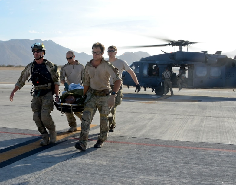 U.S. Air Force Pararescuemen from the 48th Rescue Squadron off-load patients from a 55th RQS HH-60G Pavehawk at Cabo San Lucas International Airport, Mexico, May 5, 2014. The Pavehawks extracted two injured sailors and six Guardian Angels from a ship 540 nautical miles off the Pacific Coast of Mexico, then transported by a 79th RQS HC-130J Combat King II to Naval Air Station North Island, Calif. (U.S. Air Force photo by Staff Sgt. Adam Grant/Released)