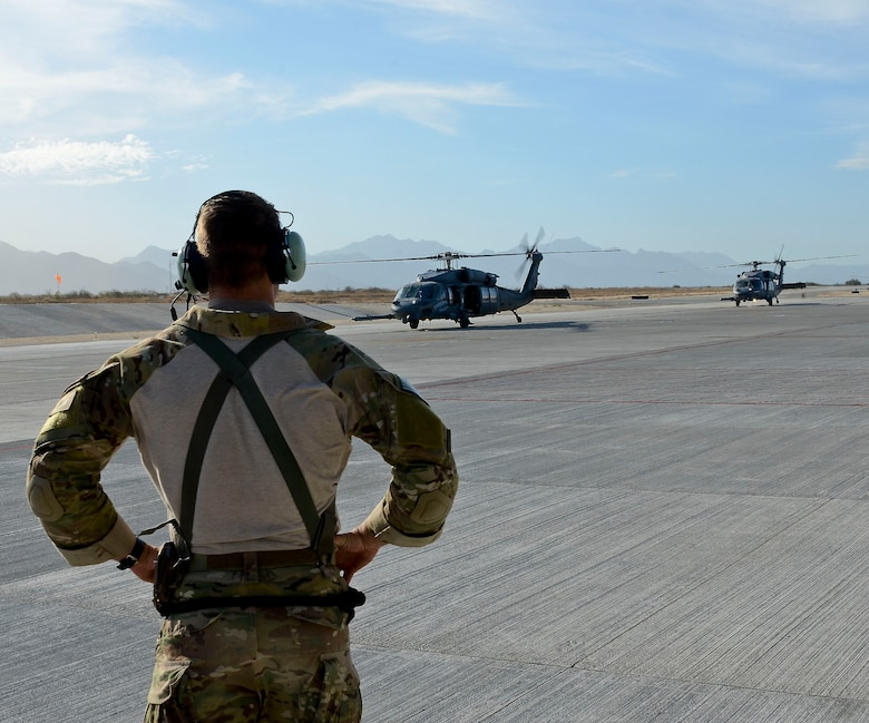 U.S. Air Force Master Sgt. Chris Young, 48th Rescue Squadron Pararescueman in control of patient transportation operations, prepares to receive injured patients from two 55th RQS HH-60G Pavehawks after they land at Cabo San Lucas International Airport, Mexico, May 5, 2014. The Pavehawks extracted two injured sailors and six Guardian Angels from a ship 540 nautical miles off the Pacific Coast of Mexico, then transported by a 79th RQS HC-130J Combat King II to Naval Air Station North Island, Calif. (U.S. Air Force photo by Staff Sgt. Adam Grant/Released