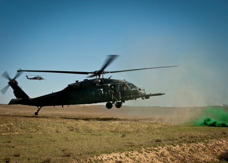 A U.S. Air Force HH-60 Pave Hawk assigned to Nellis Air Force Base, Nev. prepares to land during the terminal employment phase portion of the USAF Weapons School pilot training, April 28, 2014, at Orchard Combat Training Center, Idaho.  The weapons school trains tactical experts in the art of integrated battle-space dominance across the land, air, space and cyber domains. (U.S. Air Force photo by Senior Airman Jason Couillard)