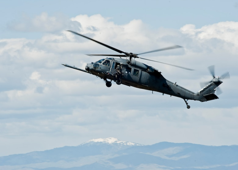 A U.S. Air Force HH-60 Pave Hawk assigned to Nellis Air Force Base, Nev. prepares to land during the U.S. Air Force Weapons School terminal employment phase portion of pilot training April 28, 2014, at Orchard Combat Training Center, Idaho. The TE mission objective is to demonstrate and instruct HH-60 Pave Hawk weapons employment and landing zone options to weapons school students by maximizing weapons proficiency and quickly recover survivors. (U.S. Air Force photo by Senior Airman Jason Couillard)