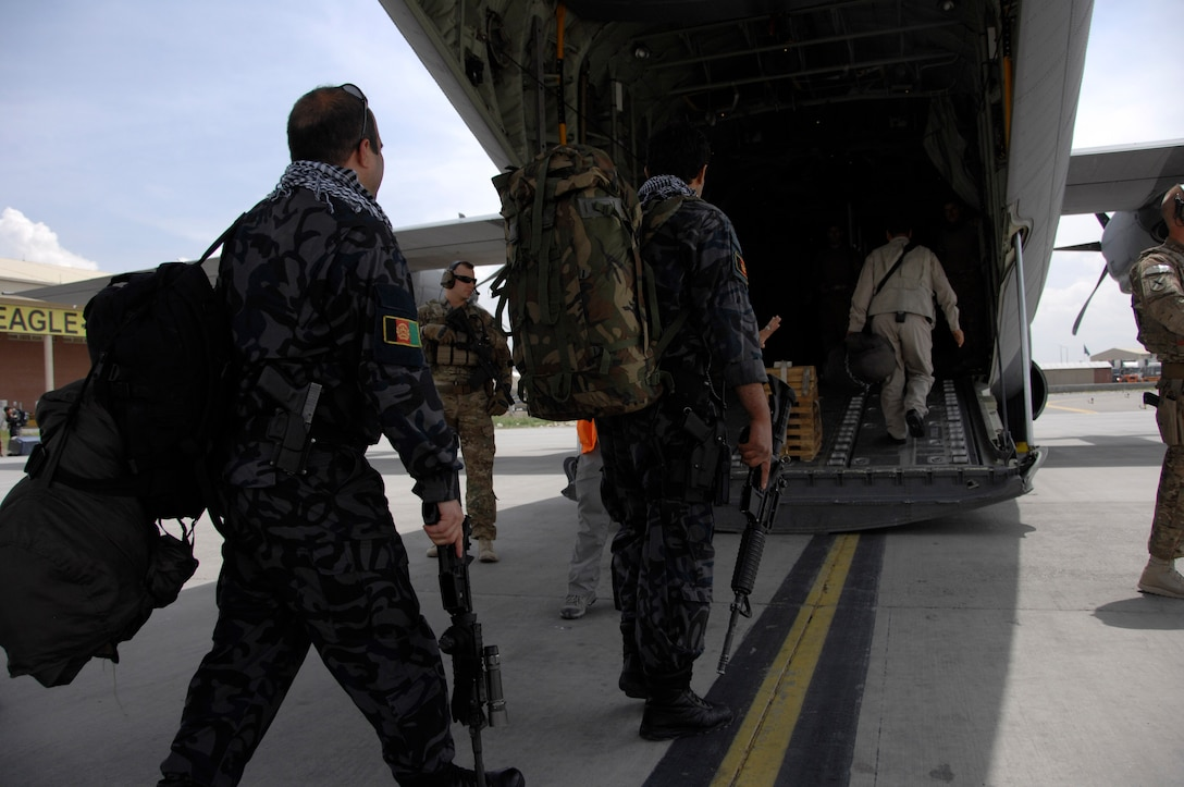 KABUL INTERNATIONAL AIRPORT, Afghanistan - Afghan National Army soldiers and advisors board a C-130 J-30 at Kabul International Airport, Afghanistan May 5, 2014. The aircraft is assigned to the 455th Air Expeditionary Wing at Bagram Airfield. Coalition forces delivered personnel and supplies to Fayzabad Airport in support of the recent mudslide in Badakhshan province. (U.S. Air Force photo by Master Sgt. Cohen A. Young)