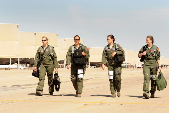 U.S. Air Force Capt. Kelly Nettleblad, Capt. Rachel Winiecki and 1st Lt. Jessica Wyble, 354th Fighter Squadron A-10 pilots and 1st Lt. Katherine Conrad 107th FS Selfridge Air National Guard Base, Michigan, A-10 pilot, walk across the flight line to their aircraft at Davis-Monthan Air Force Base, Ariz., May 5, 2014. They flew in a four ship together for Nettleblad's final flight with the 354th Bulldogs. (U.S. Air Force photo be Airman 1st Class Cheyenne Morigeau/Released)