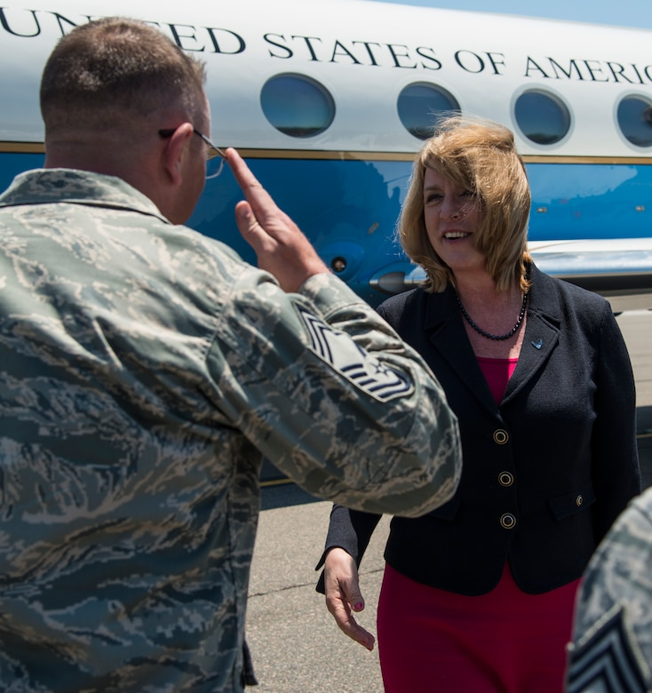 Chief Master Sgt. David Wade, 437th Maintenance Group superintendent, salutes Secretary of the Air Force Deborah Lee James as he welcomes her to Joint Base Charleston, S.C., May 6, 2014. James is the 23rd Secretary of the Air Force and was appointed to the position Dec. 20, 2013. She is responsible for the affairs of the Department of the Air Force, including organizing, training, equipping and providing for the welfare of its more than 690,000 active-duty, Guard, Reserve and civilian Airmen and their families. (U.S. Air Force photo/ Airman 1st Class Clayton Cupit)