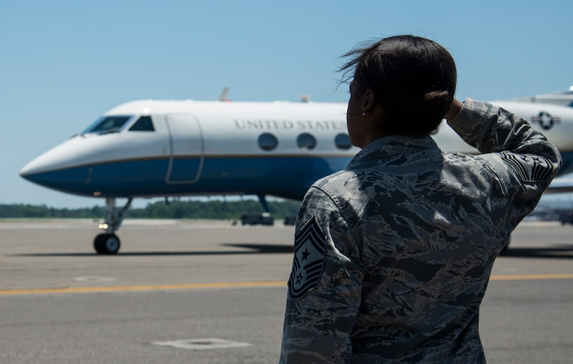 Chief Master Sgt. Gigi Manning, 315th Airlift Wing command chief, salutes Secretary of the Air Force Deborah Lee James' aircraft as she arrives at Joint Base Charleston, S.C., May 6, 2014. James is the 23rd Secretary of the Air Force and was appointed to the position Dec. 20, 2013. She is responsible for the affairs of the Department of the Air Force, including organizing, training, equipping and providing for the welfare of its more than 690,000 active-duty, Guard, Reserve and civilian Airmen and their families. (U.S. Air Force photo/ Airman 1st Class Clayton Cupit)