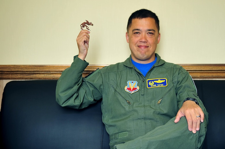 "Lt. Col. Donn Yates, 334th Fighter Squadron commander, with ""The Gremlin"", May 2, 2014, at Seymour Johnson Air Force Base, N.C. The Gremlin was employed during World War II by Royal Air Force Pilot Officer James Harrington as a good luck charm in flight. (U.S. Air Force photo/Airman 1st Class Shawna Keyes)"