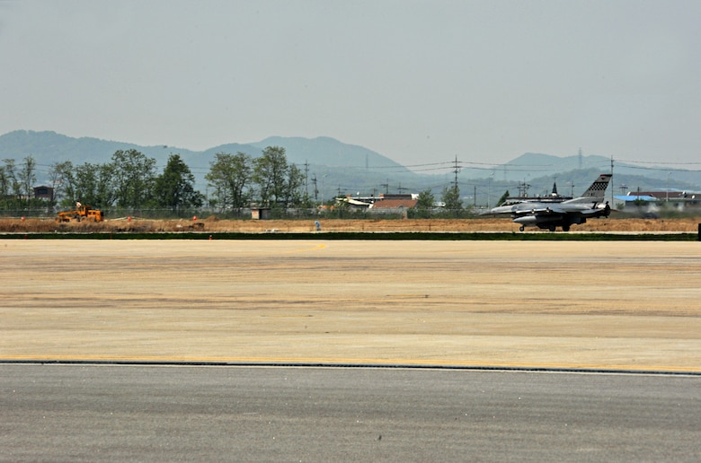 An F-16 Fighting Falcon from the 36th Fighter Squadron touches down after a training sortie during Operational Readiness Exercise Beverly Bulldog 14-02 at Osan Air Base, Republic of Korea, May 6, 2014. Aircrews and pilots work together to accomplish flying sorties during OREs as they would in a real-world contingency operation. (U.S. Air Force photo/Airman 1st Class Ashley J. Thum)