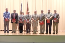 "Lieutenant Gen. Robert Neller, commander of U.S. Marine Corps Central Command, presented the Secretary of Defense Medal for the Global War on Terrorism to nine MARCENT ""Civilian"" Marines  at the base theatre aboard
