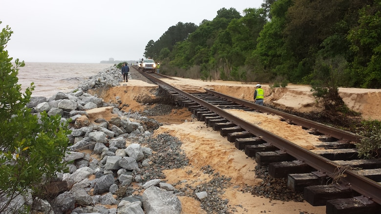 Corps initiates emergency permitting program in response to April storm, which left severe damages in its wake, like those shown here on the railroad tracks adjacent to the road washout on the Scenic Highway in Pensacola.