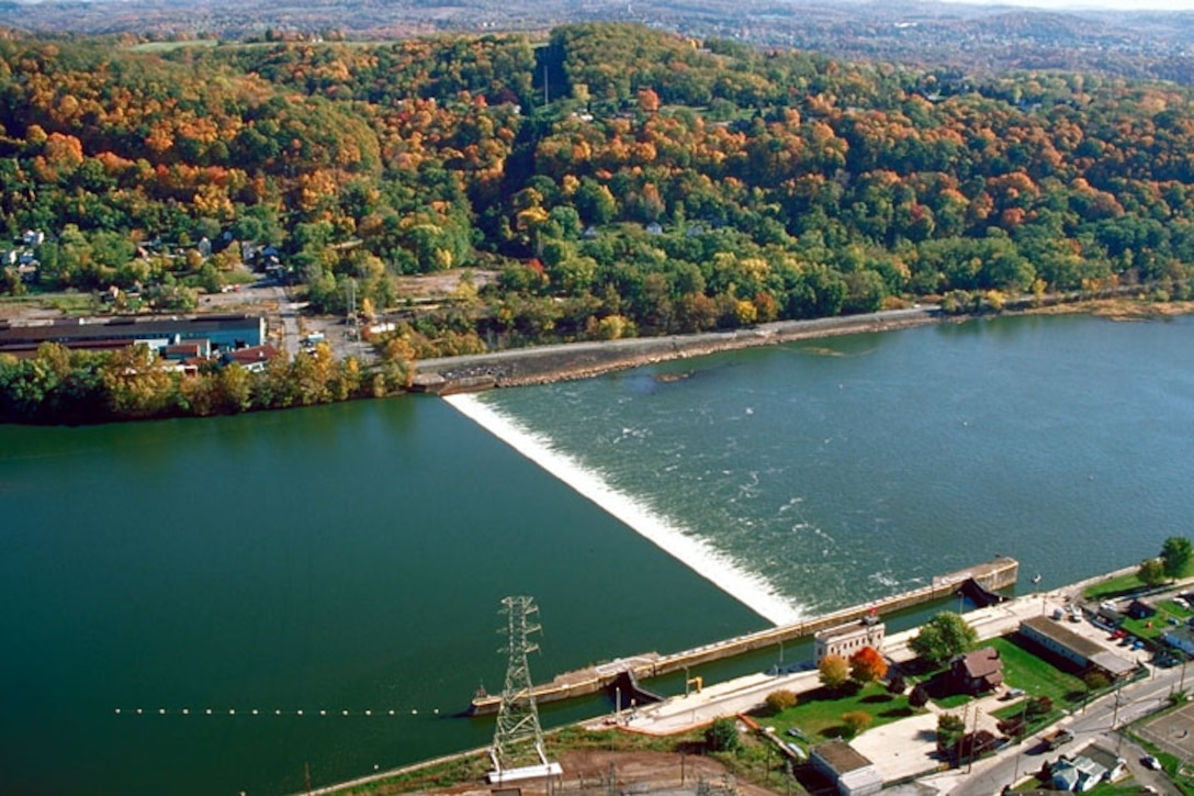 A fixed crest dam is difficult to see from a small boat moving downriver since the crest is normally covered with flowing water.