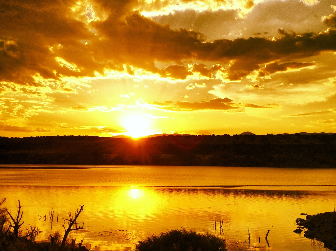 COCHITI LAKE, N.M., -- The Tetilla Peak recreation area at Cochiti Lake has amazing sunsets.  Sept. 29, 2012 happened to be a golden one. Photo by Karyn Matthews.