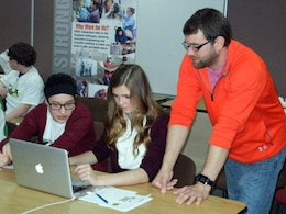 An Urbana Middle School teacher helps students get started with the DimensionU tools.