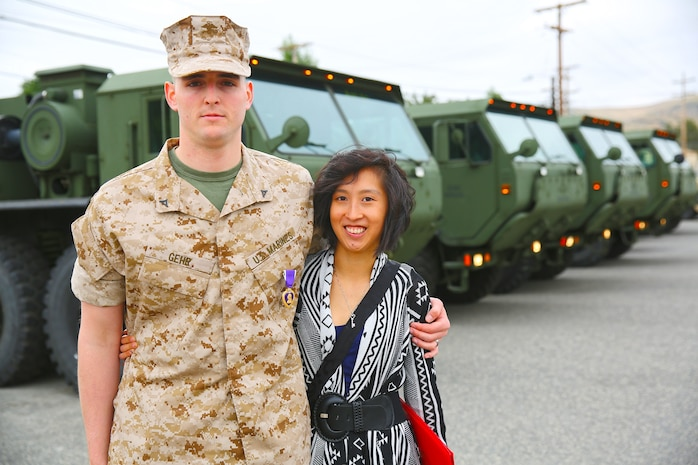 Lance Cpl. Gabriel R. Gehr, electrical equipment system technician with Utilities Platoon, Engineer Maintenance Company, 1st Maintenance Battalion, 1st Marine Logistics Group, poses with his wife, Kaitlyn, after receiving the Purple Heart aboard Camp Pendleton, Calif., May 5, 2014. More than a year earlier on Nov. 20, 2013, Gehr sustained shrapnel injuries from an anti-tank rocket while supporting Operation Enduring Freedom. Gehr, 21, is from Delphos, Ohio.