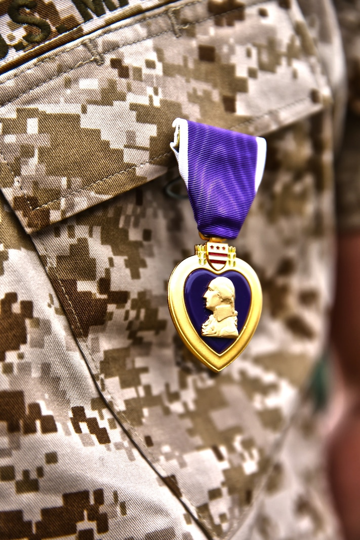 Lance Cpl. Gabriel R. Gehr, electrical equipment system technician with Utilities Platoon, Engineer Maintenance Company, 1st Maintenance Battalion, 1st Marine Logistics Group, wears the Purple Heart after receiving the medal aboard Camp Pendleton, Calif., May 5, 2014. More than a year earlier on Nov. 20, 2013, Gehr sustained shrapnel injuries from an anti-tank rocket while supporting Operation Enduring Freedom.