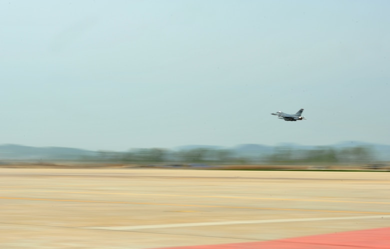 An F-16 Fighting Falcon from the 36th Fighter Squadron takes to the skies during Operational Readiness Exercise Beverly Bulldog 14-02 at Osan Air Base, Republic of Korea, May 7, 2014. OREs give aircrews and pilots from both of Osan's fighter squadrons critical time to practice performing at the optimum level needed to succeed during real-world contingency operations. (U.S. Air Force photo/Airman 1st Class Ashley J. Thum)