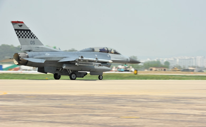 An F-16 Fighting Falcon from the 36th Fighter Squadron taxis down the runway during Operational Readiness Exercise Beverly Bulldog 14-02 at Osan Air Base, Republic of Korea, May 7, 2014. The 51st Fighter Wing has flown more than 100 training sorties since the start of BB 14-02. (U.S. Air Force photo/Airman 1st Class Ashley J. Thum)