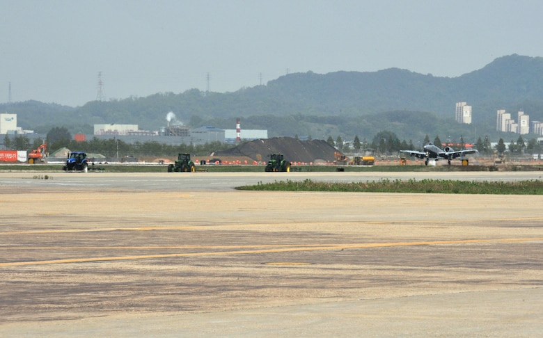 An A-10 Thunderbolt II from the 25th Fighter Squadron touches down after returning from a training sortie during Operational Readiness Exercise Beverly Bulldog 14-02 at Osan Air Base, Republic of Korea, May 7, 2014. Training sorties are an integral part of any ORE, along with practicing other wartime skills like base defense; chemical, biological, radiological and nuclear decontamination; and self-aid and buddy care. (U.S. Air Force photo/Airman 1st Class Ashley J. Thum)