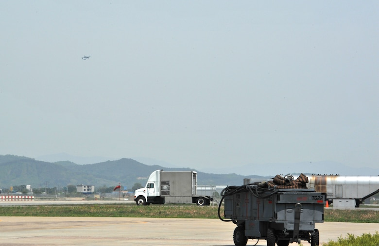 An A-10 Thunderbolt II from the 25th Fighter Squadron descends in preparation for landing during Operational Readiness Exercise Beverly Bulldog 14-02 at Osan Air Base, Republic of Korea, May 7, 2014. The 25th and 36th Fighter Squadrons are key to helping United States Forces Korea maintain stability on the Korean peninsula. (U.S. Air Force photo/Airman 1st Class Ashley J. Thum)