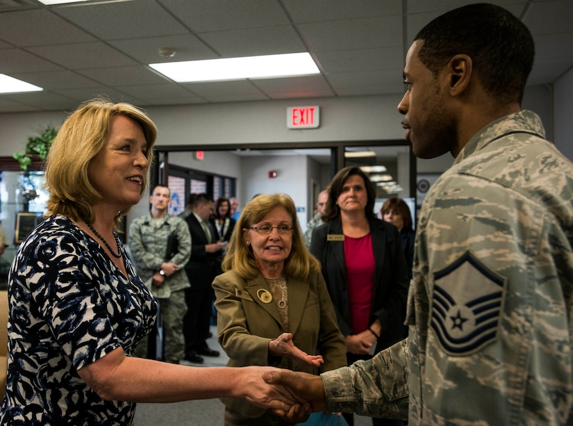 Secretary of the Air Force Deborah Lee James is greeted by members of the 628th Force Support Squadron May 6, 2014, at Joint Base Charleston, S.C. James is the 23rd Secretary of the Air Force and was appointed to the position Dec. 20, 2013. She is responsible for the affairs of the Department of the Air Force, including organizing, training, equipping and providing for the welfare of its more than 690,000 active-duty, Guard, Reserve and civilian Airmen and their families. (U.S. Air Force photo/ Senior Airman Dennis Sloan)