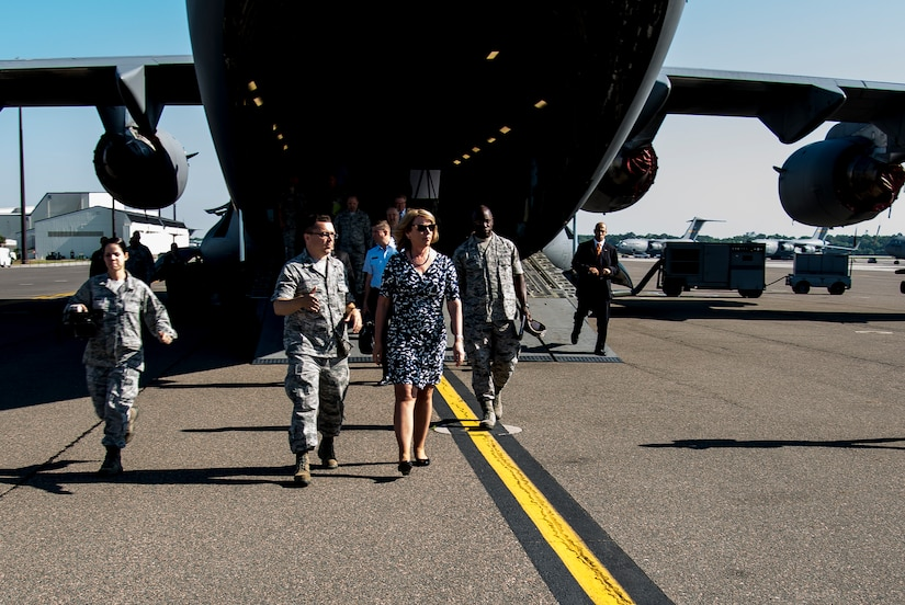 Secretary of the Air Force Deborah Lee James is escorted from a C-17 Globemaster III by Maj. Christopher Carmichael, 437th Aerial Port Squadron commander May 6, 2014, at Joint Base Charleston, S.C. James is the 23rd Secretary of the Air Force and was appointed to the position Dec. 20, 2013. She is responsible for the affairs of the Department of the Air Force, including organizing, training, equipping and providing for the welfare of its more than 690,000 active-duty, Guard, Reserve and civilian Airmen and their families. (U.S. Air Force photo/ Airman 1st Class Clayton Cupit)