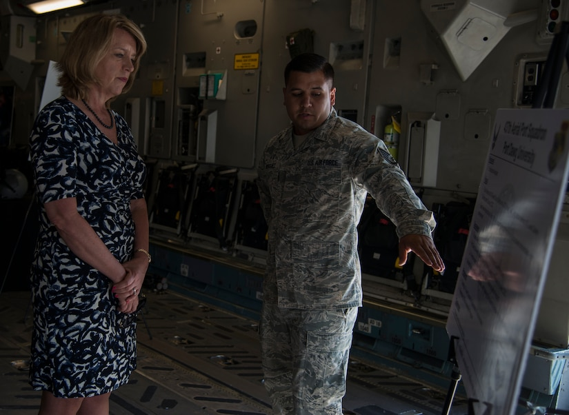 """Secretary of the Air Force Deborah Lee James is briefed by Staff Sgt. Michael Rodriguez, inside a C-17 Globemaster III, May 6, 2014, on the flight line at Joint Base Charleston, S.C. Rodriguez is a member of the 437th Aerial Port Squadron and was briefing the SECAF on """"Port Dawg University."""" James is the 23rd Secretary of the Air Force and was appointed to the position Dec. 20, 2013. She is responsible for the affairs of the Department of the Air Force, including organizing, training, equipping and providing for the welfare of its more than 690,000 active-duty, Guard, Reserve and civilian Airmen and their families.  (U.S. Air Force photo/ Airman 1st Class Clayton Cupit)"""
