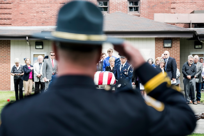 Joint Base Lewis-McChord Police officer Lt. Robert Rothrock salutes the casket of Air Force Capt. Douglas D. Ferguson May 2, 2014, as the McChord Honor Guard transfers Ferguson's remains to the hearse following the funeral service at Joint Base Lewis-McChord, Wash. Ferguson was later laid to rest close to where his parents were buried at Mountain View Funeral Home in Lakewood, Wash. (U.S. photo/Tech. Sgt. Sean Tobin)