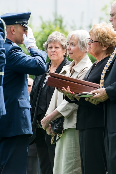 Col. Anthony Davit, 627th Air Base Group commander, salutes as he presents an encased flag to Sue Scott, sister of Air Force Capt. Douglas D. Ferguson May 2, 2014, in Lakewood, Wash. Ferguson's F-4D aircraft was shot down over Laos in 1969 and his remains were returned home after being missing for more than 44 years. (U.S. Air Force photo/Tech. Sgt. Sean Tobin)