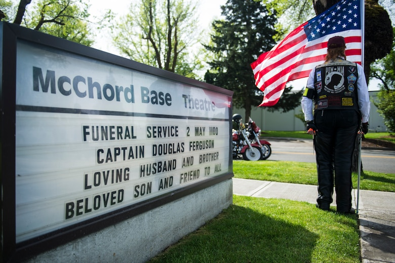 A member of the Patriot Guard Riders stands guard outside the McChord Theater April 2, 2014, at Joint Base Lewis-McChord. Dozens of Patriot Guard Riders stood guard during the funeral service of Capt. Douglas D. Ferguson whose airplane was shot down during the Vietnam War in 1969. (U.S. Air Force photo/Tech. Sgt. Sean Tobin)