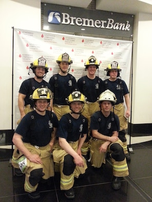 148th Fighter Wing firefighters, Duluth, Minn. pose for a group photo in Minneapolis, Minn. April 5, 2014.  The firefighters were in Minneapolis to particpate in Big Climb-Minneapolis to help raise money for the Leukemia and Lymphoma Society.  (Courtesy Photo)