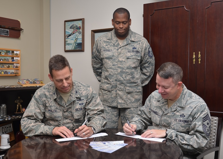 Col. Paul Welch (left), 24th Air Force vice commander, and Chief Master Sgt. Brendan Criswell (right), 24th AF command chief, contribute to the Air Force Assistance Fund.  According to Master Sgt. Antonio Hatcher (center), AFAF representative for 24th Air Force, the campaign for donations ends May 16.  (U.S. Air Force photo by:  24th Air Force Public Affairs)